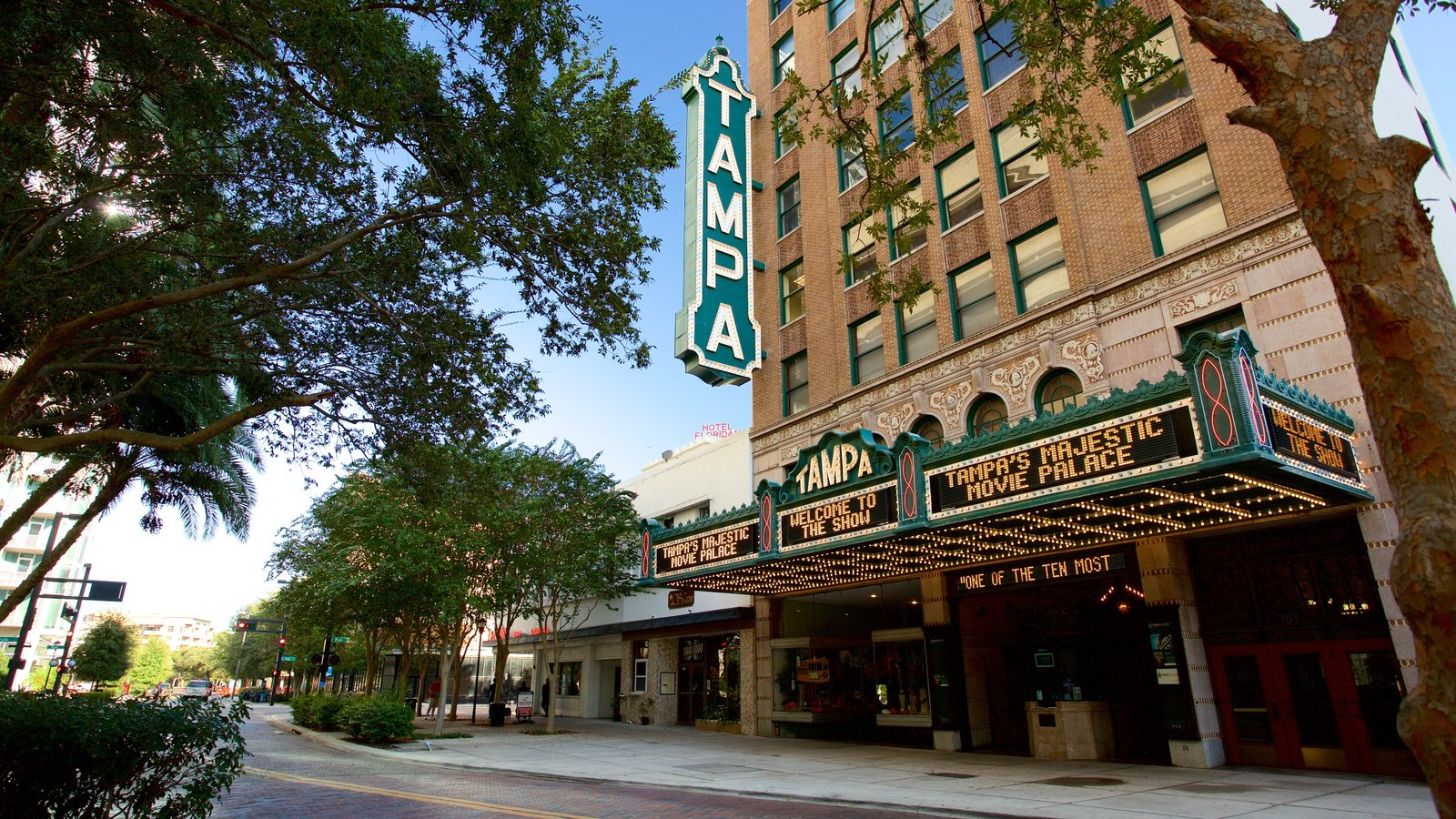 Tampa Theater which includes signage, theater scenes and heritage architecture