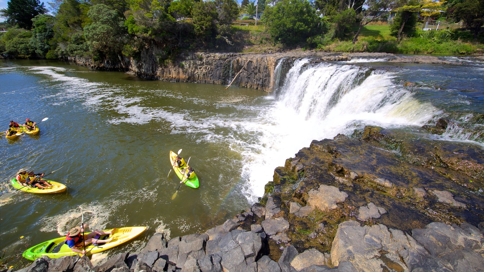 Haruru Falls showing kayaking or canoeing, a river or creek and a cascade