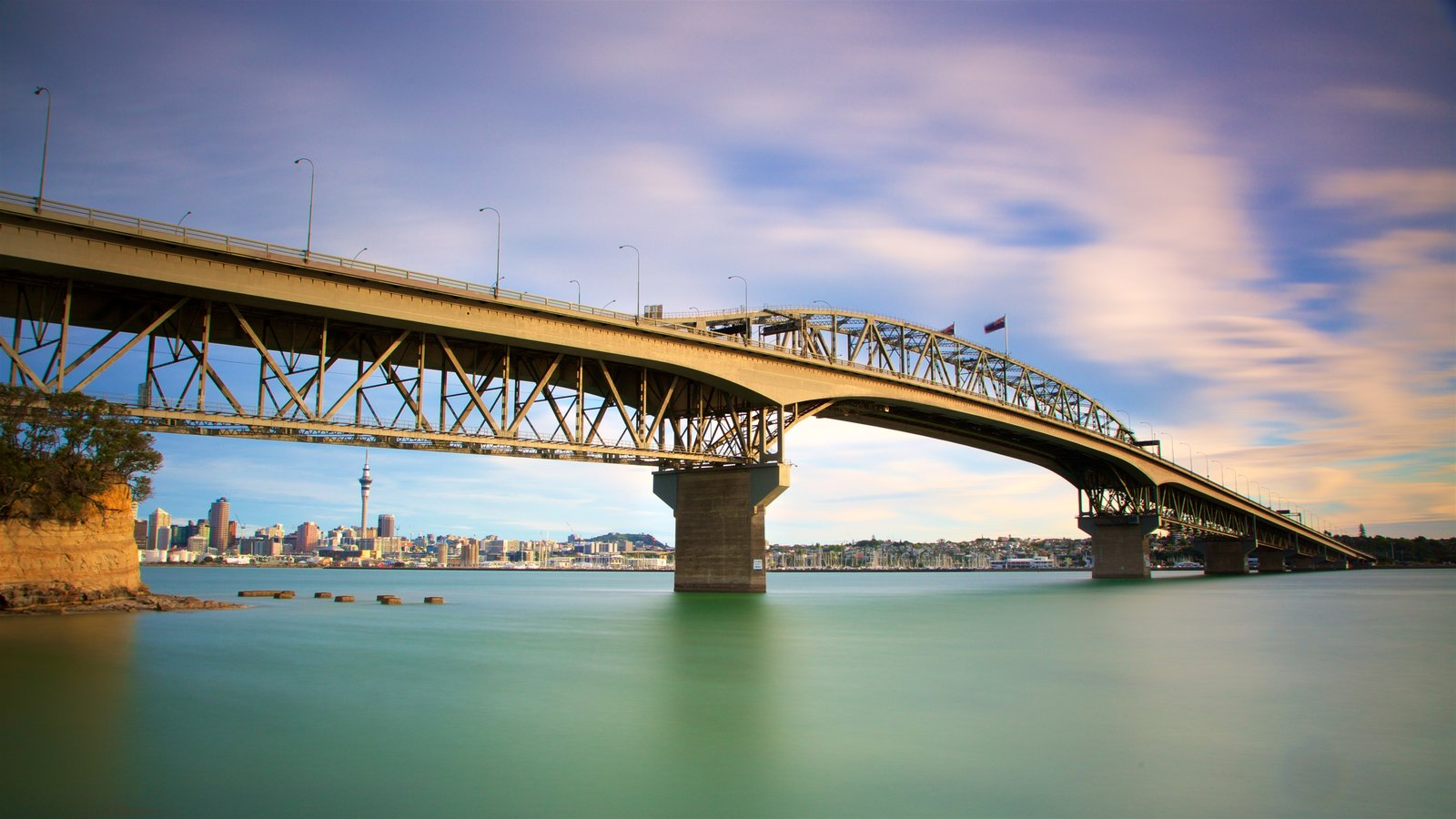 Harbour Bridge showing a city, a bay or harbor and a sunset