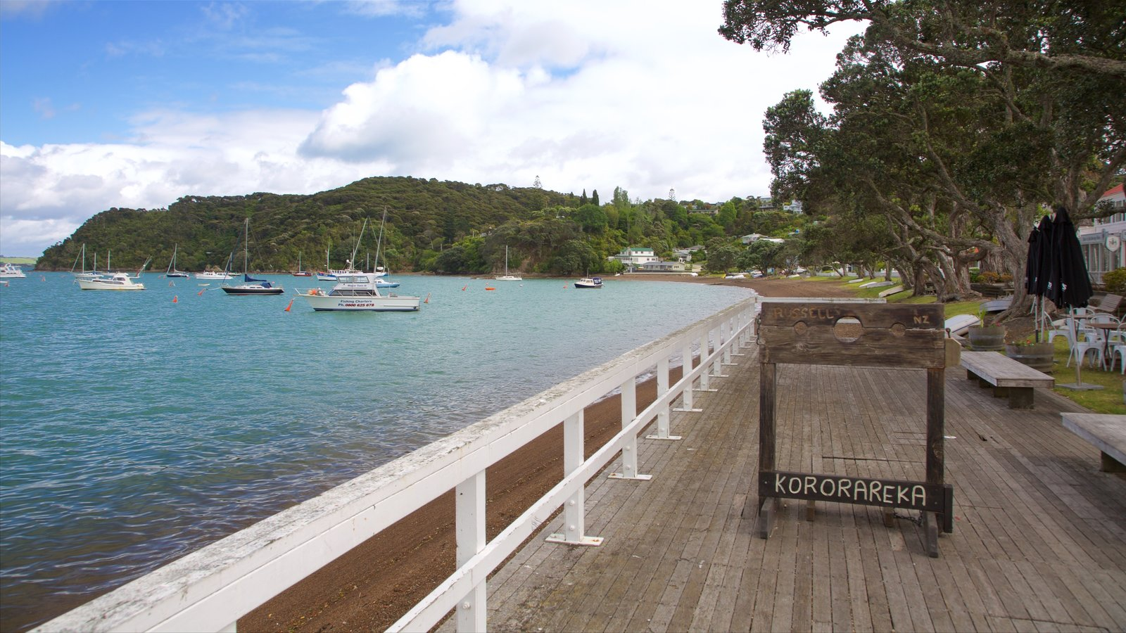 Russell Beach which includes a bay or harbor and general coastal views