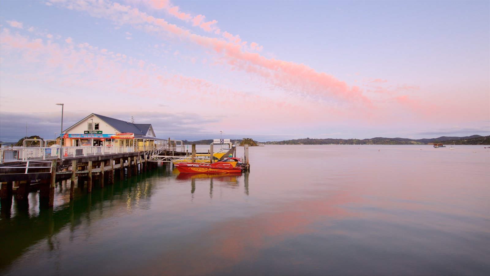 Paihia featuring a bay or harbor and a sunset