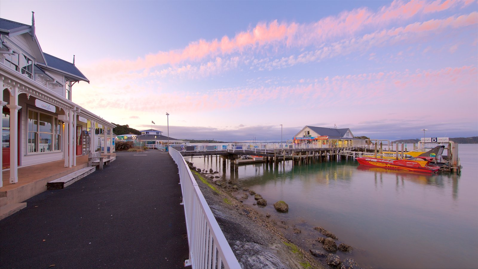 Paihia which includes a marina, a sunset and a bay or harbor