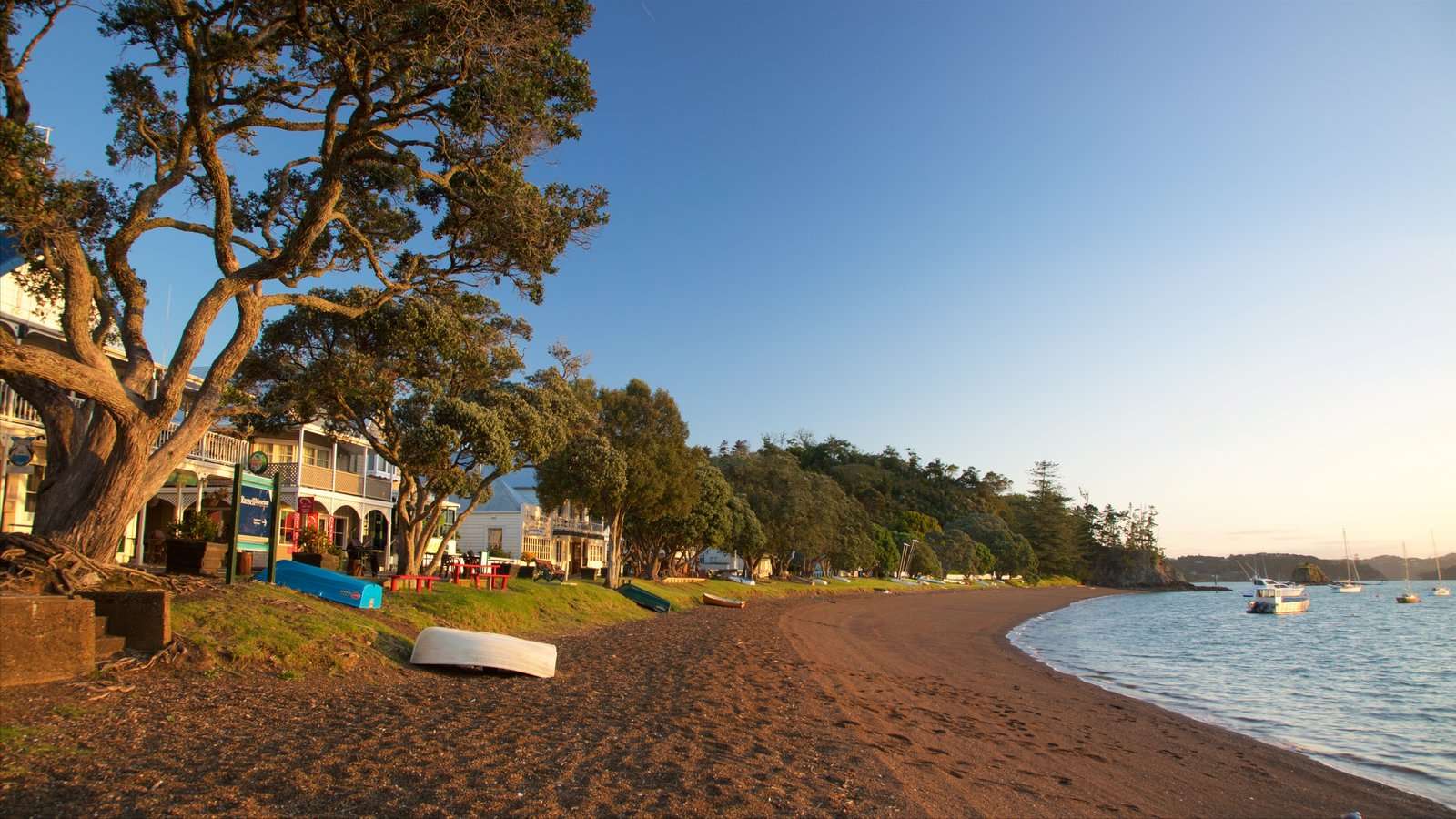 Russell Beach featuring a bay or harbor, a coastal town and a sandy beach