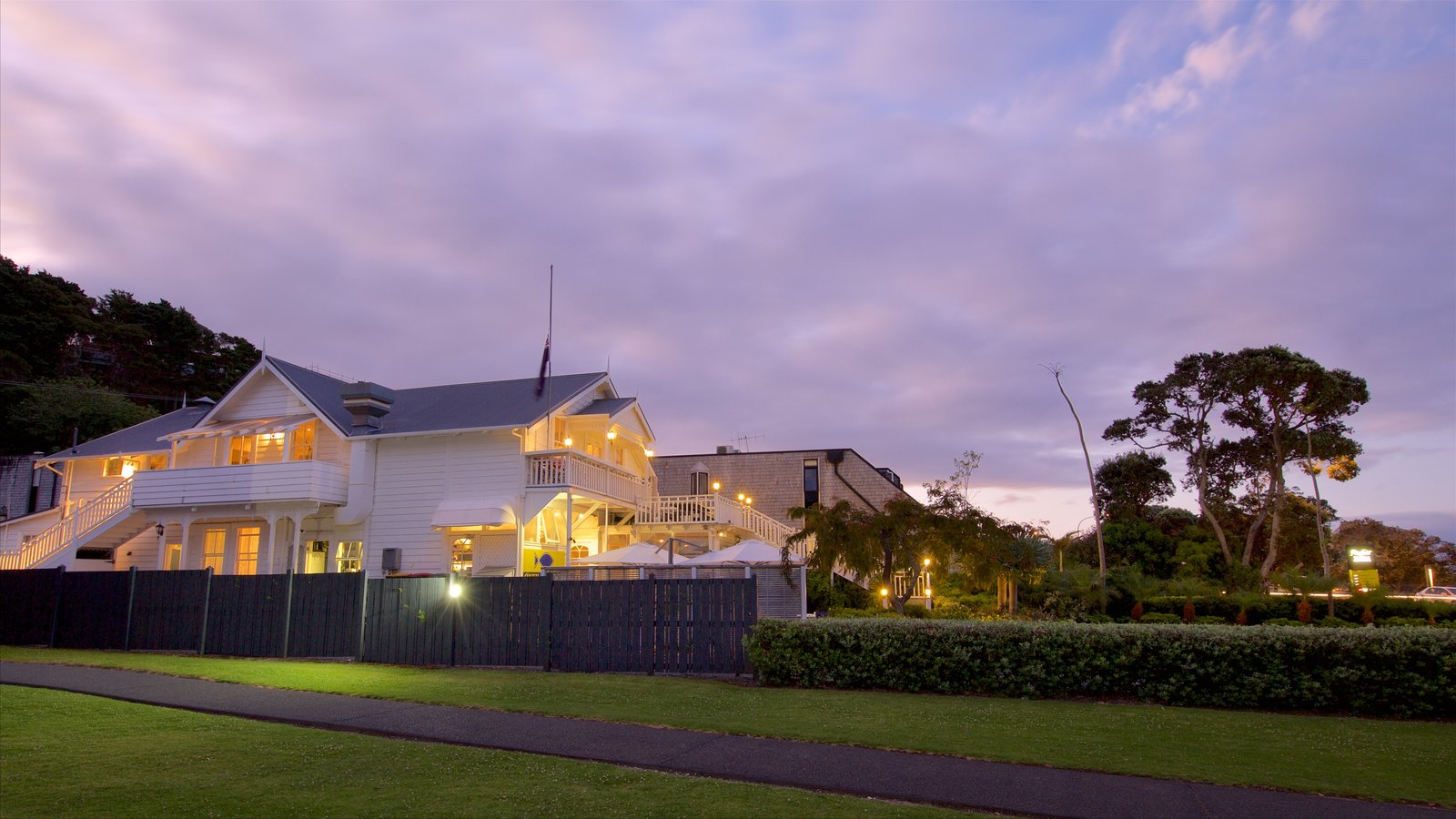 Paihia which includes a sunset and a house