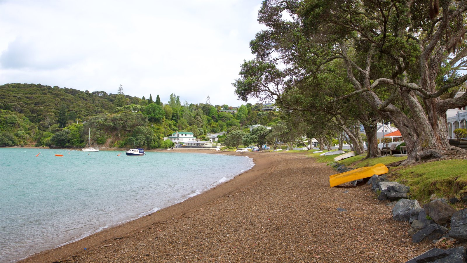 Russell Beach which includes a pebble beach and a bay or harbor