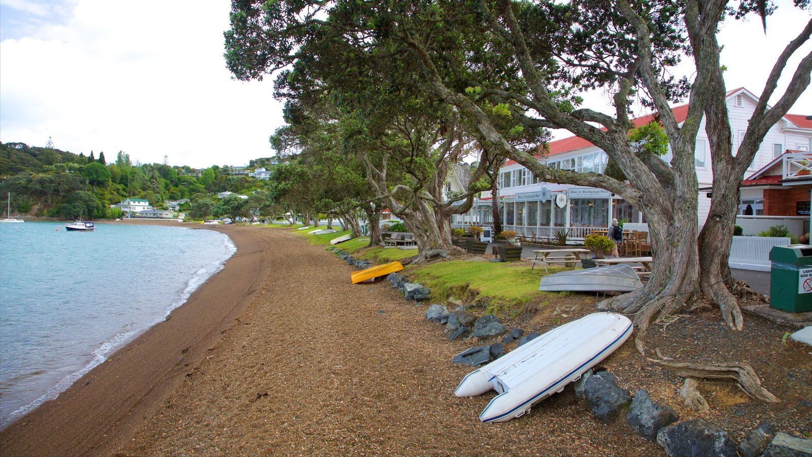 Russell Beach which includes a coastal town, a bay or harbor and a pebble beach