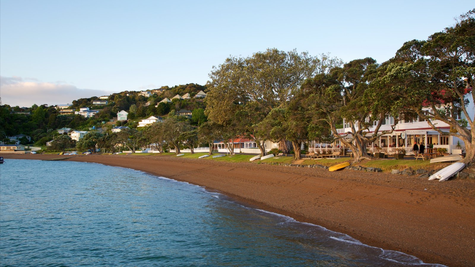 Russell Beach showing a coastal town, a pebble beach and a bay or harbor