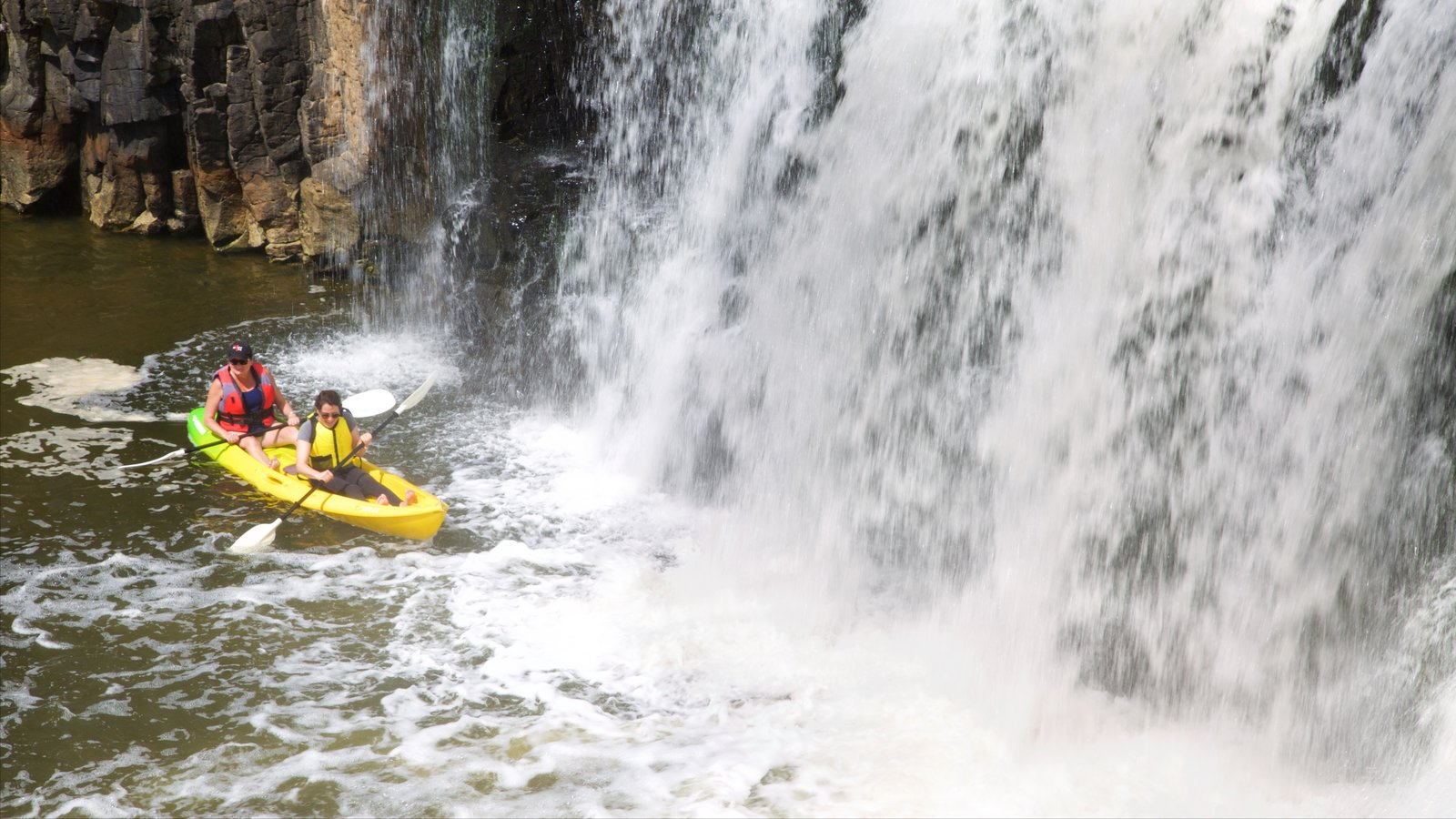 Haruru Falls which includes kayaking or canoeing, a waterfall and a river or creek