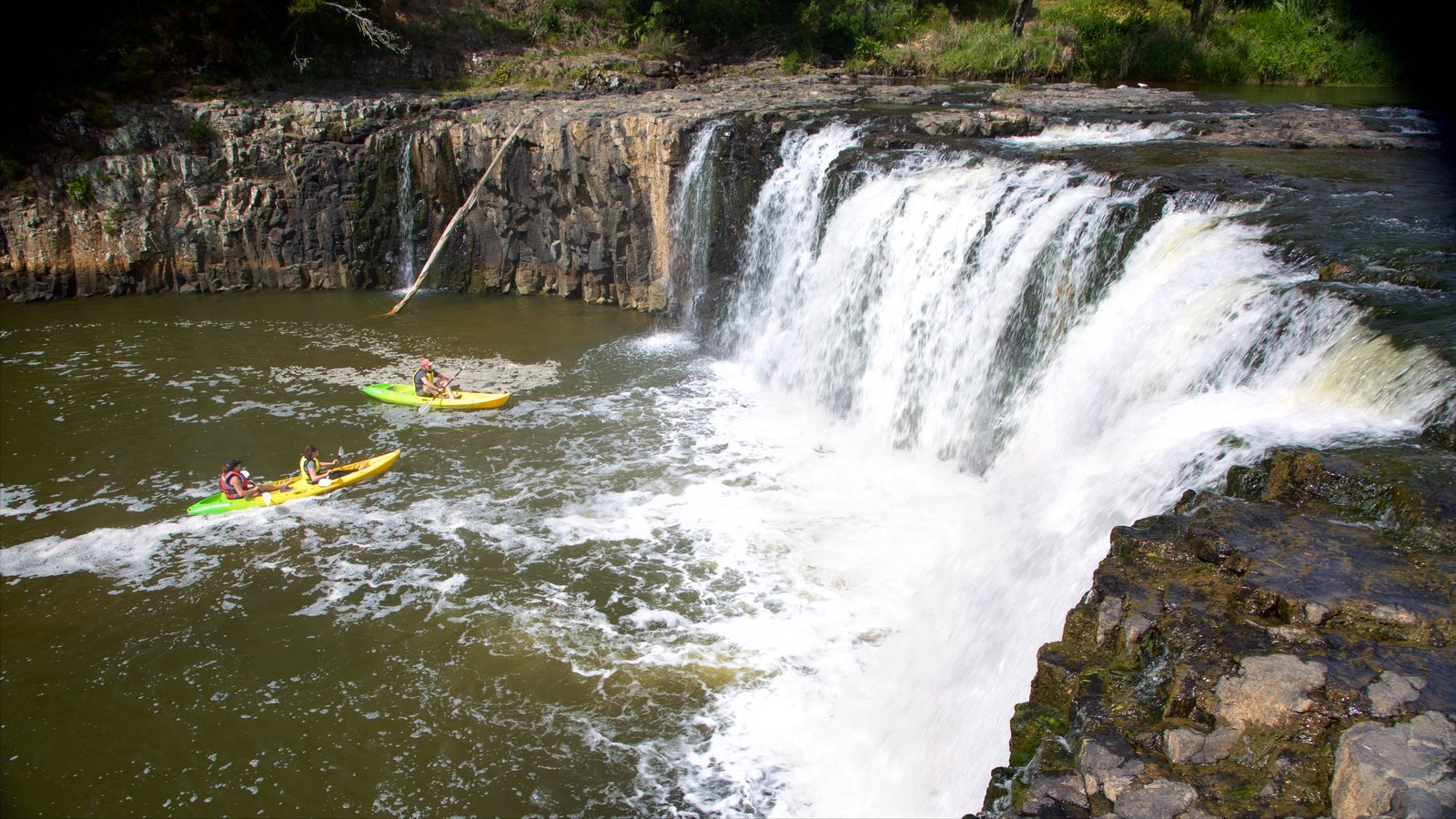 Haruru Falls showing kayaking or canoeing, a river or creek and a waterfall