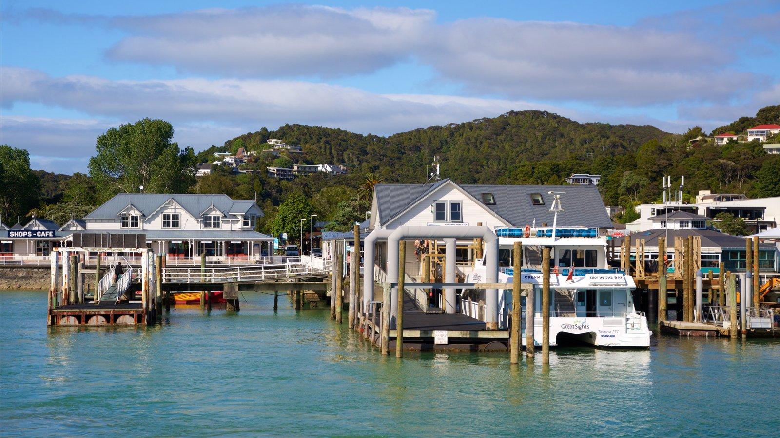 Paihia Wharf featuring a bay or harbor and a coastal town