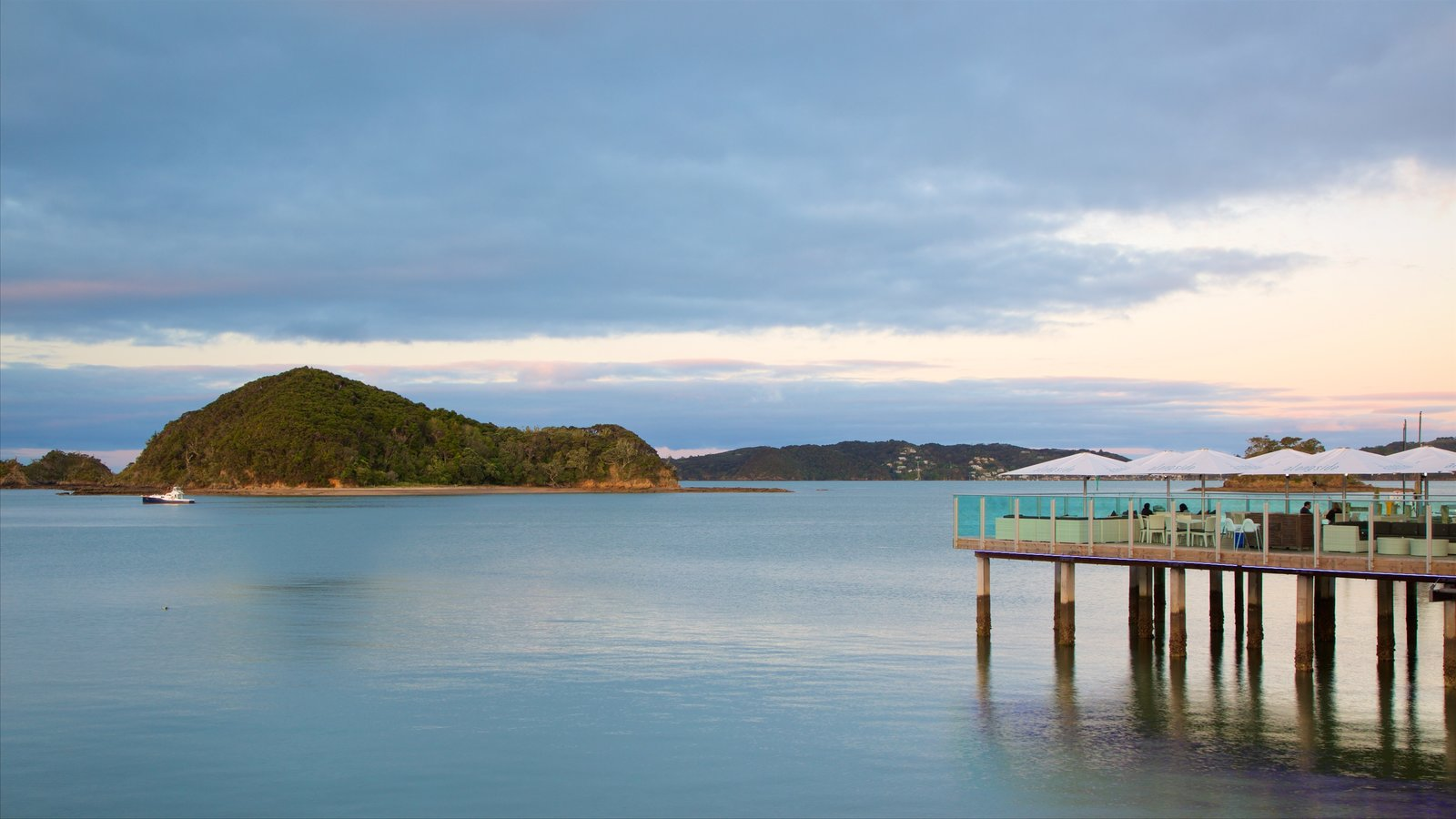 Paihia Wharf showing cafe scenes, a bay or harbor and a sunset