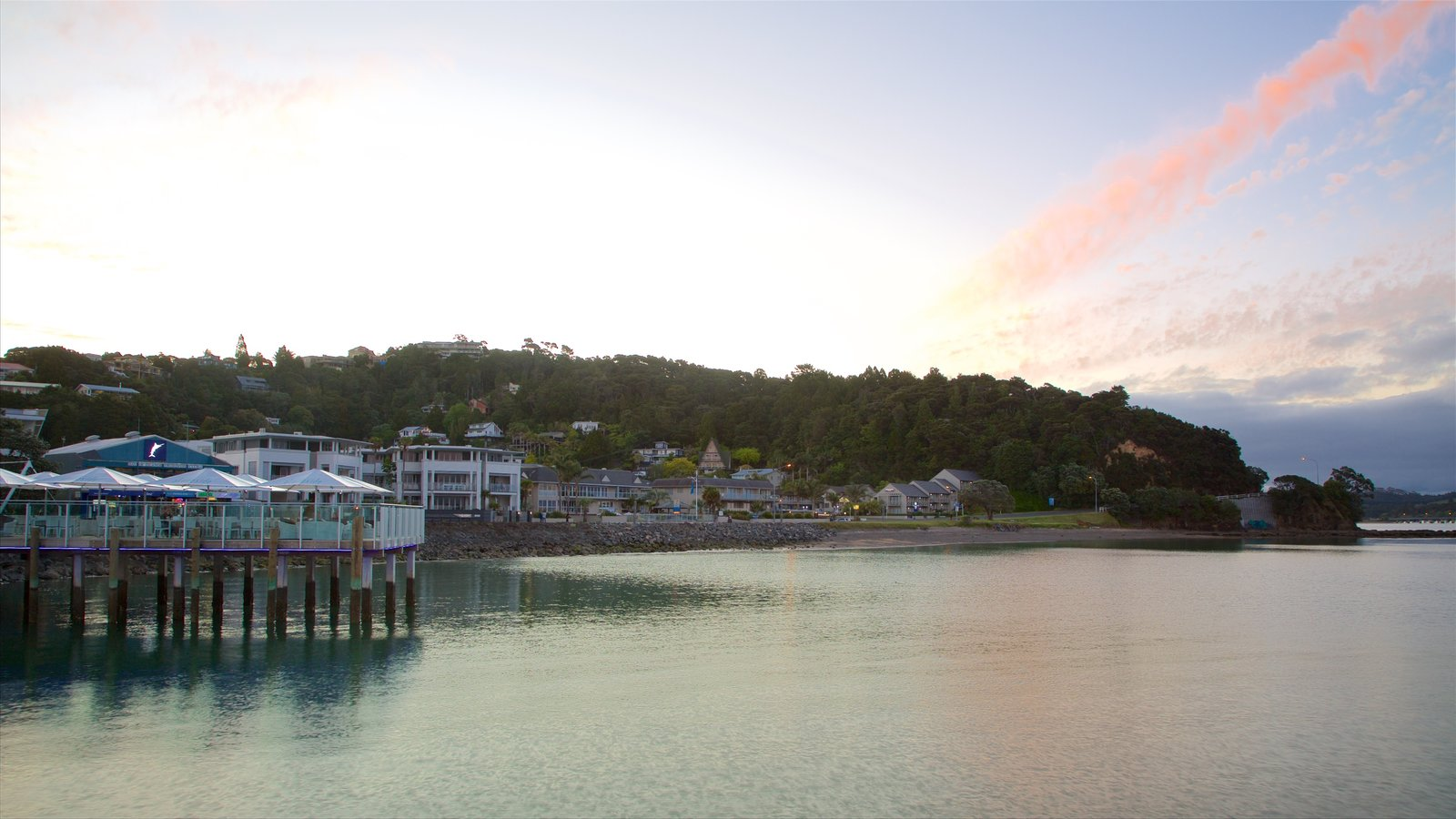 Paihia Wharf featuring a bay or harbor, a coastal town and a sunset