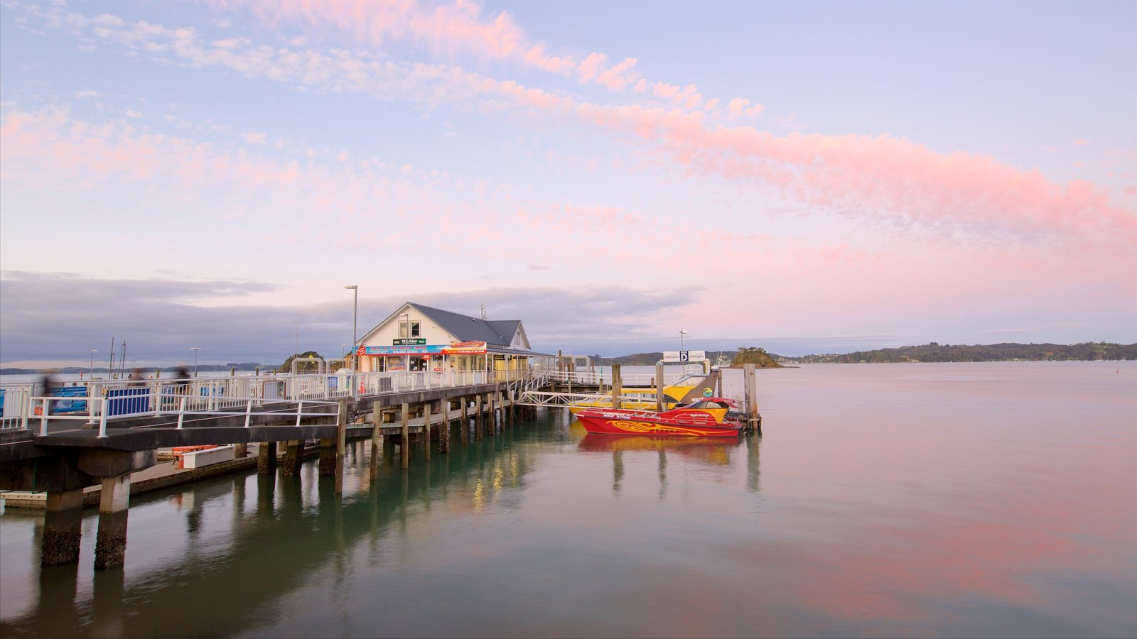 Paihia Wharf which includes a sunset and a bay or harbor