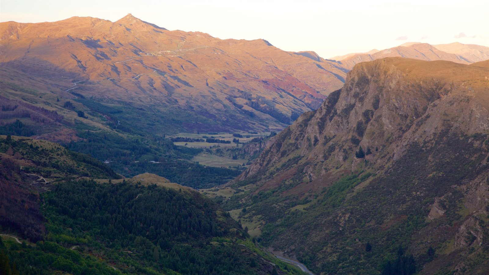 Queenstown featuring mountains and a sunset