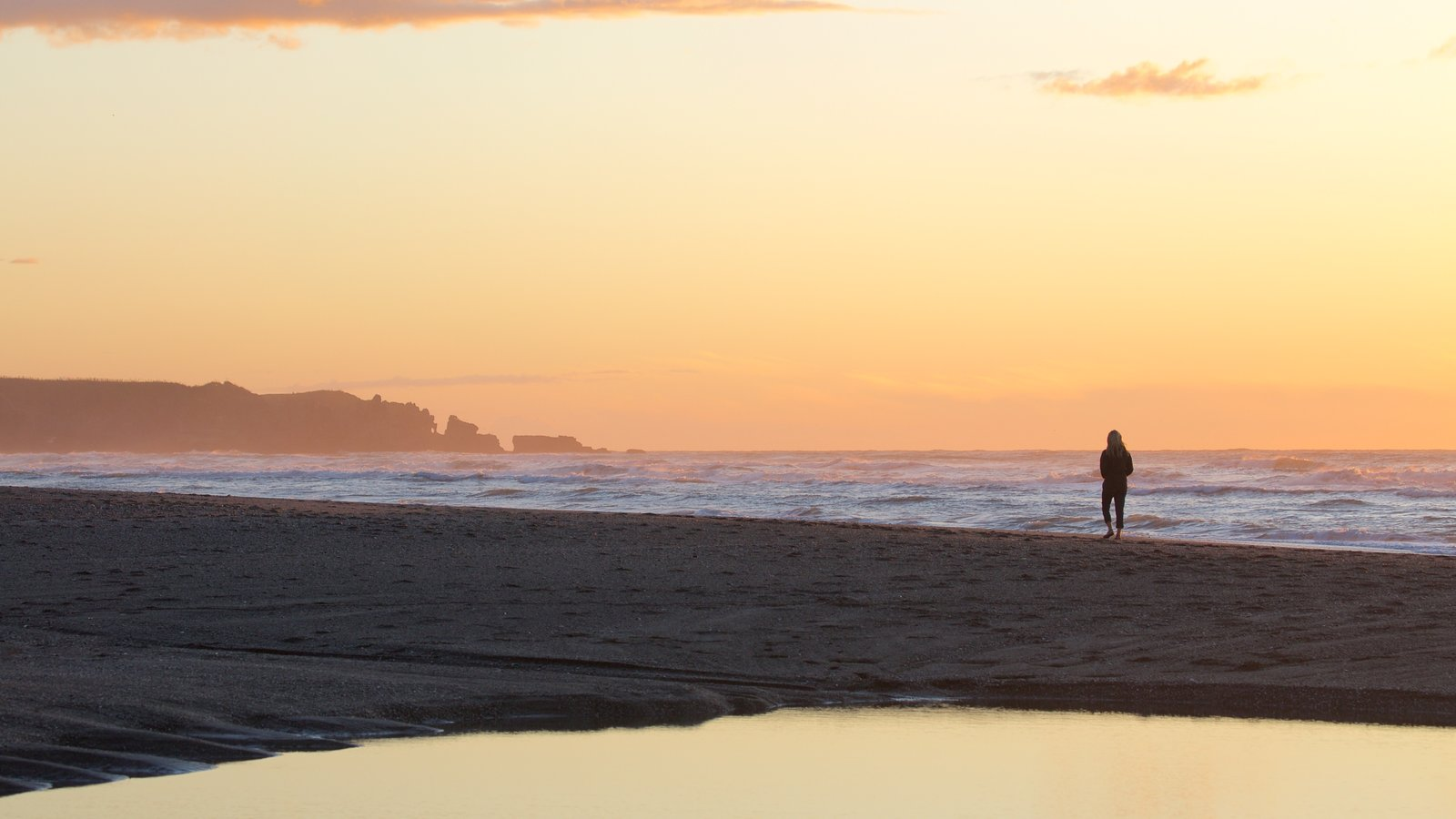 greymouth featuring a sandy beach a sunset and surf