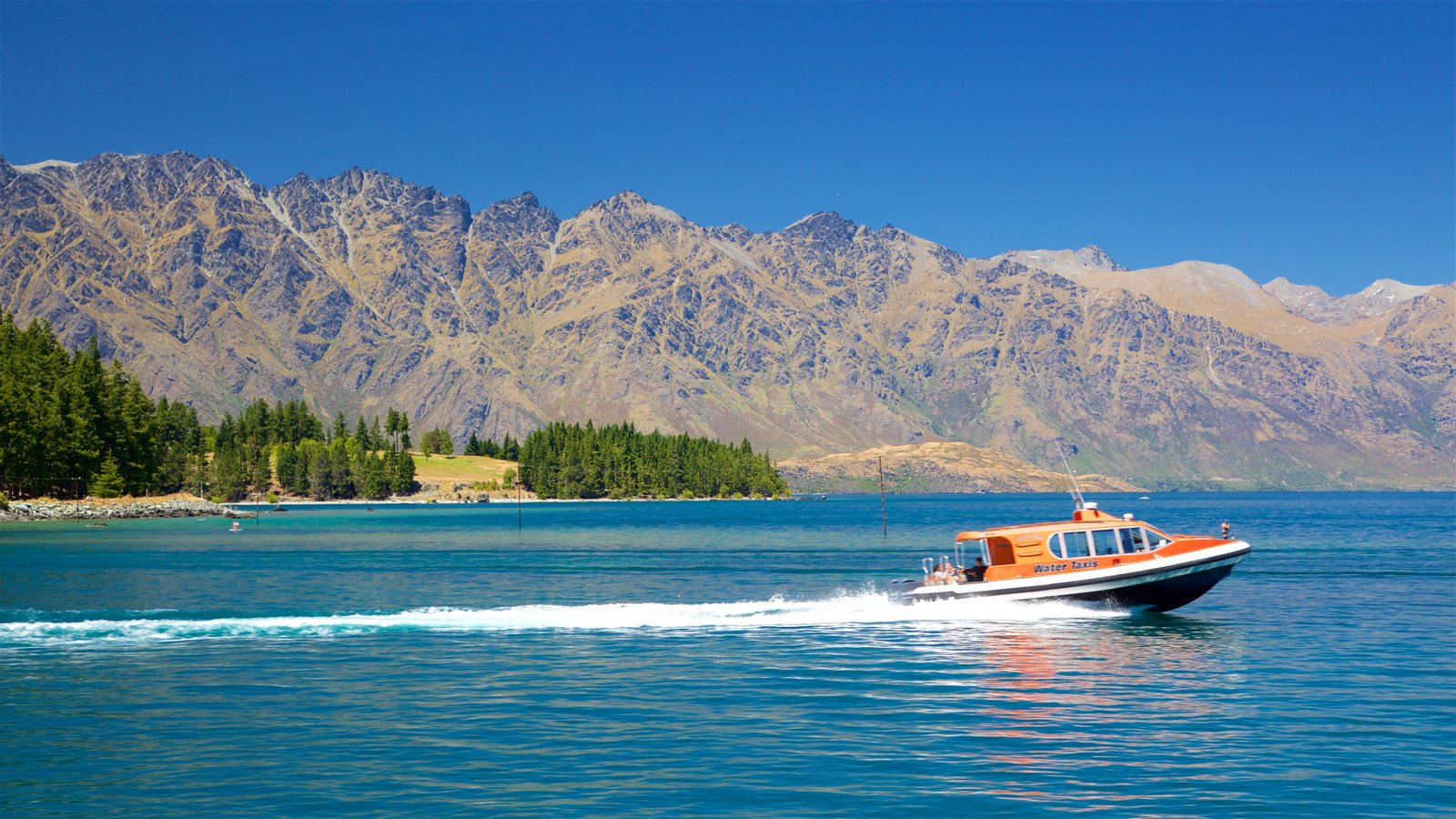 The Remarkables Ski Area which includes a lake or waterhole, boating and mountains