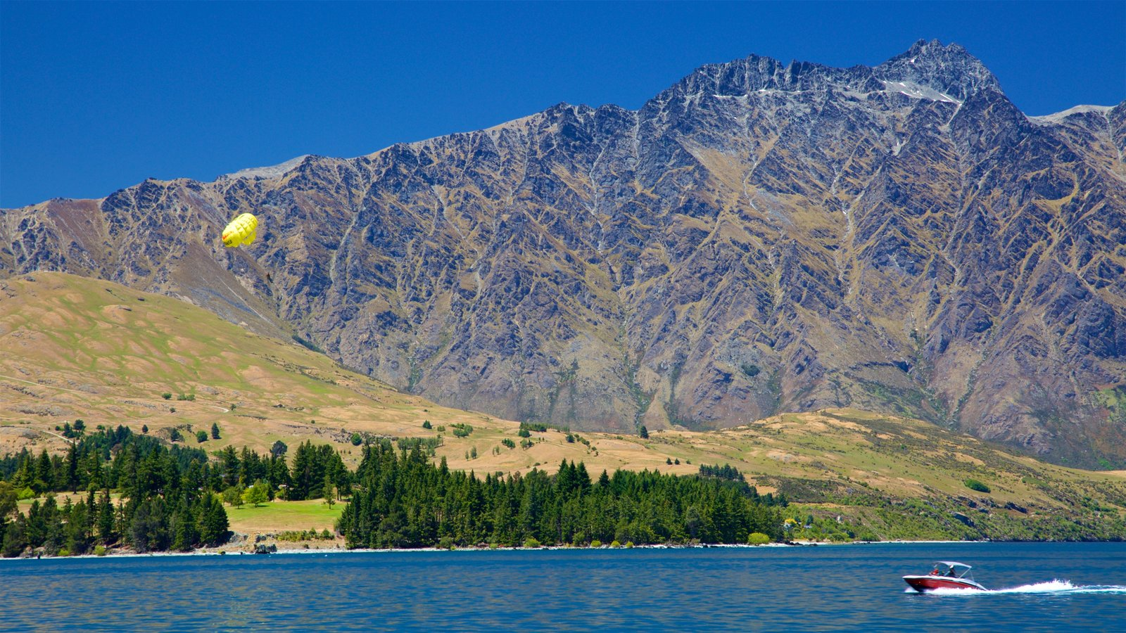 The Remarkables Ski Area which includes mountains, parasailing and a lake or waterhole