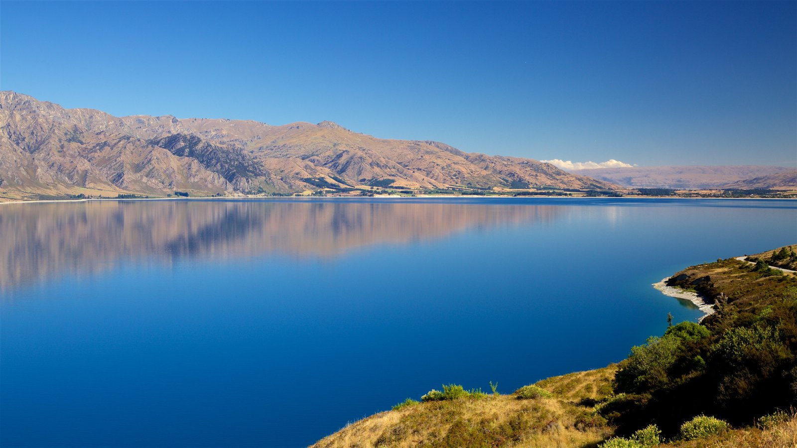 Lake Hawea featuring a lake or waterhole and mountains