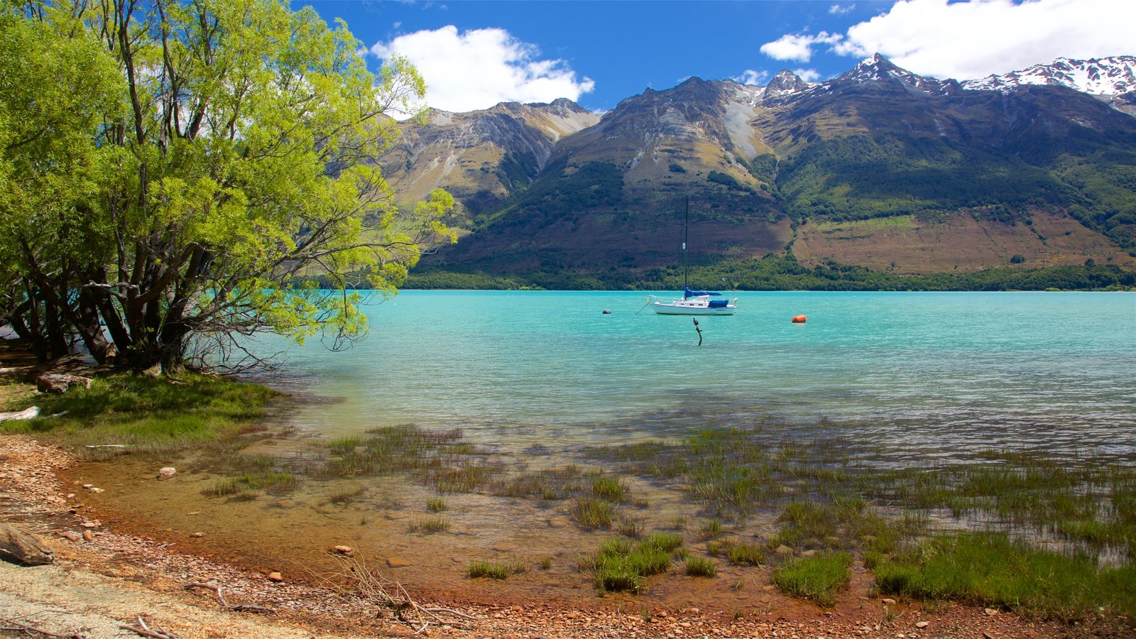 Glenorchy which includes sailing, mountains and a lake or waterhole