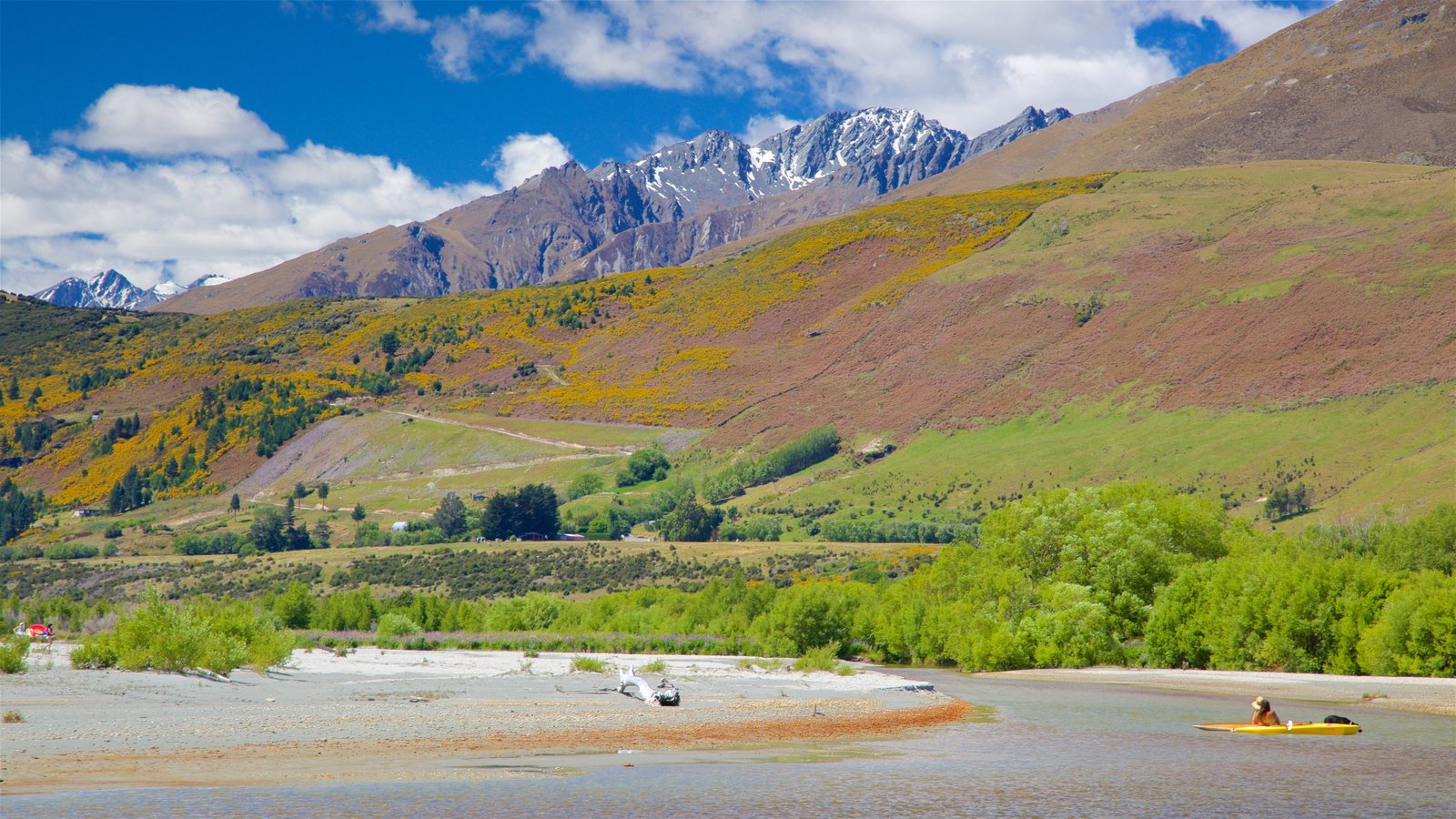 Glenorchy showing a pebble beach, kayaking or canoeing and mountains