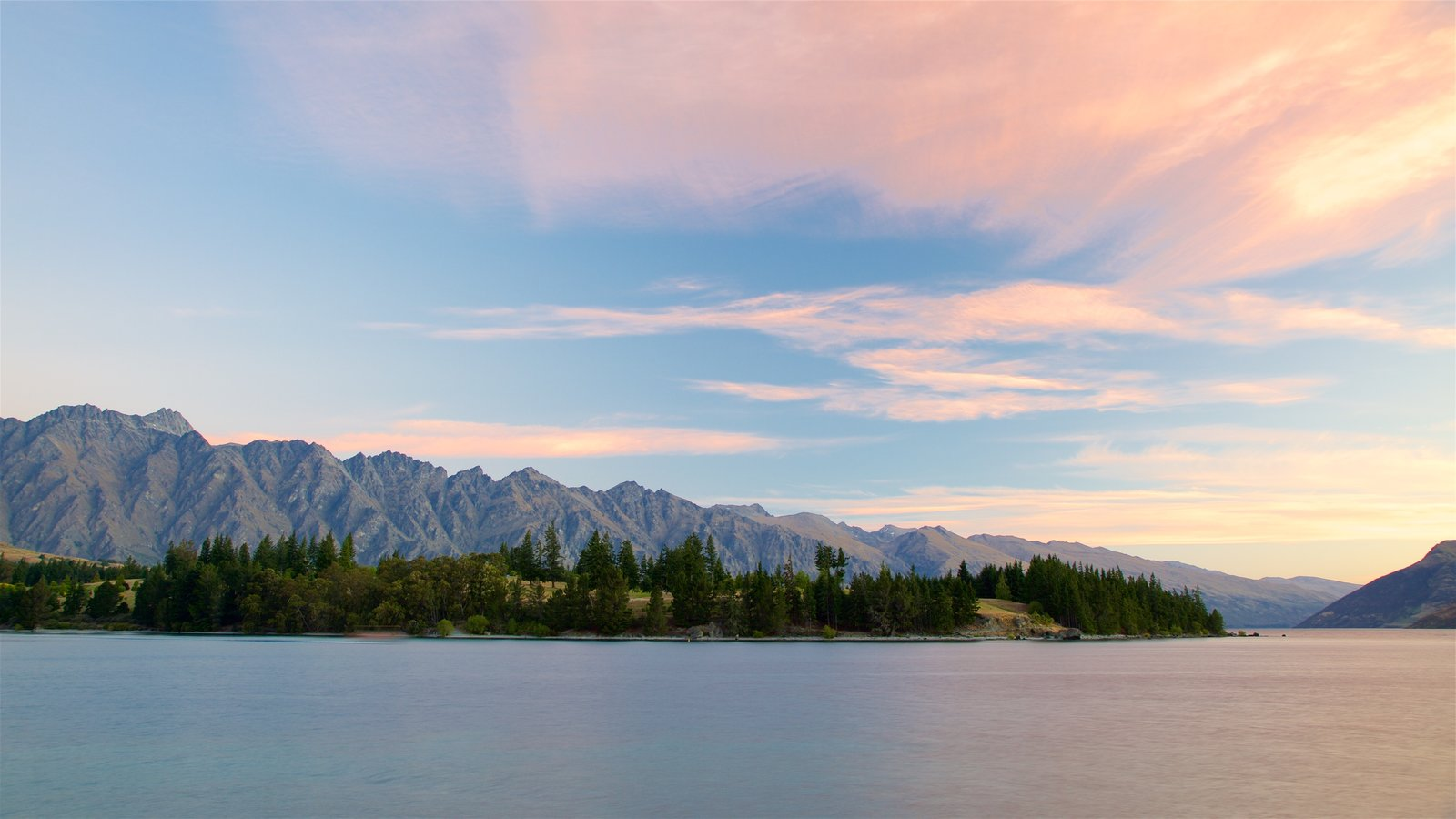 Lake Wakatipu which includes forests, a sunset and a lake or waterhole