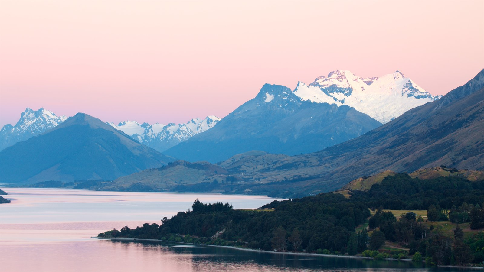 Lake Wakatipu which includes mountains, snow and a sunset