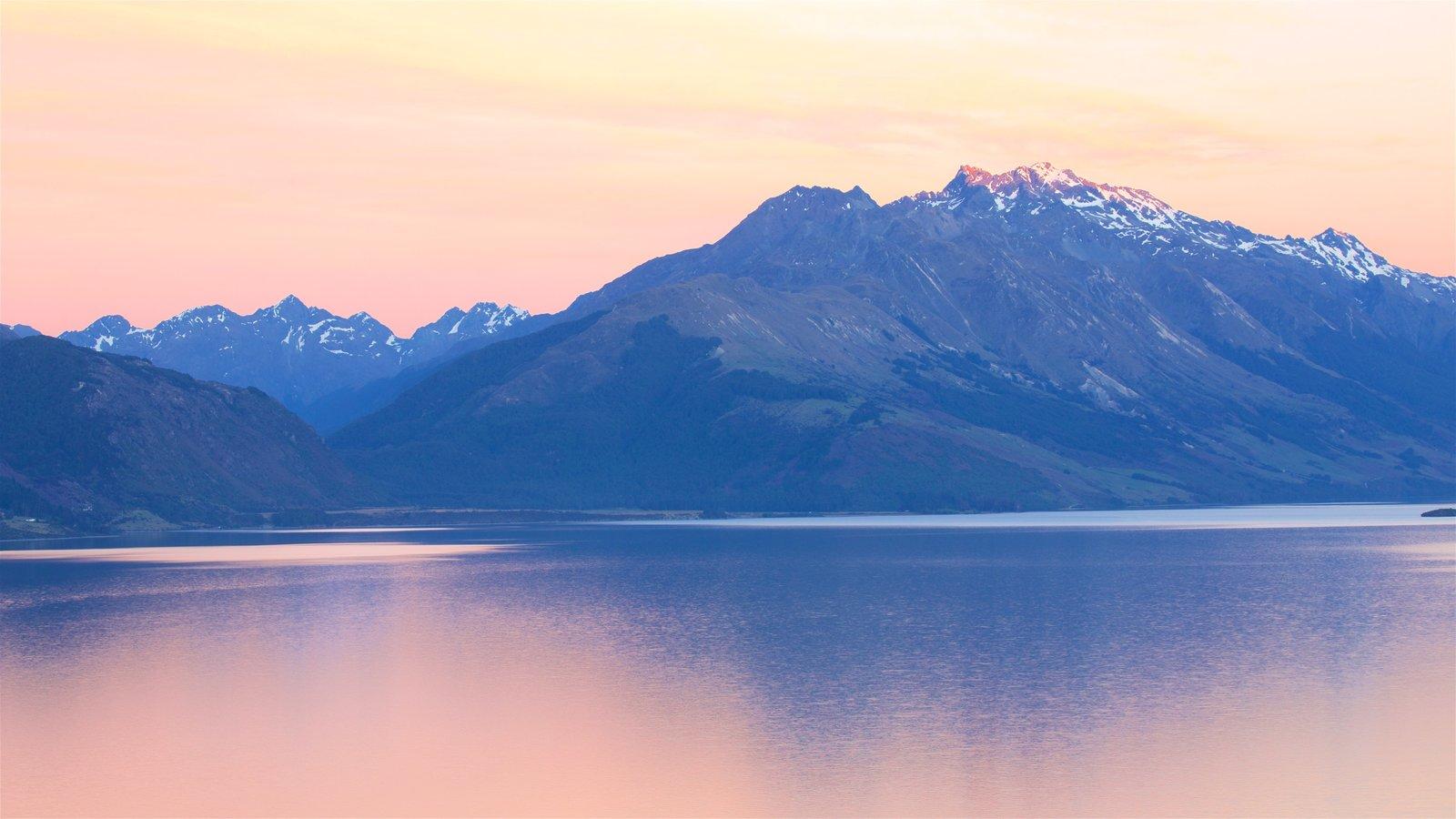 Lake Wakatipu featuring mountains, a lake or waterhole and a sunset