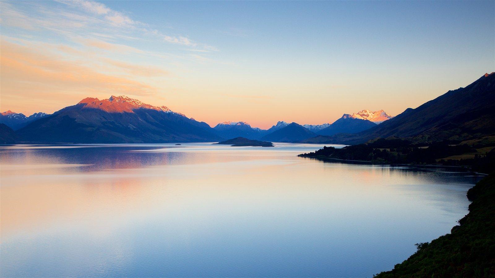 Lake Wakatipu featuring a lake or waterhole, mountains and a sunset