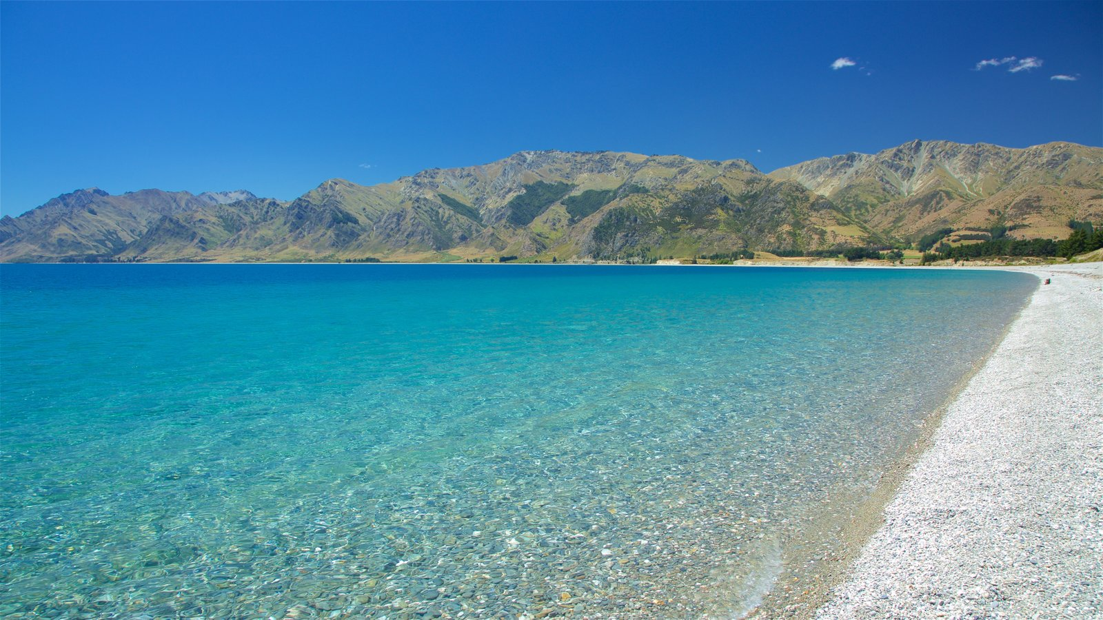 Lake Hawea which includes mountains and a lake or waterhole
