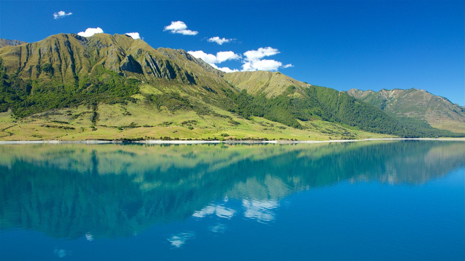 Lake Hawea featuring mountains and a lake or waterhole