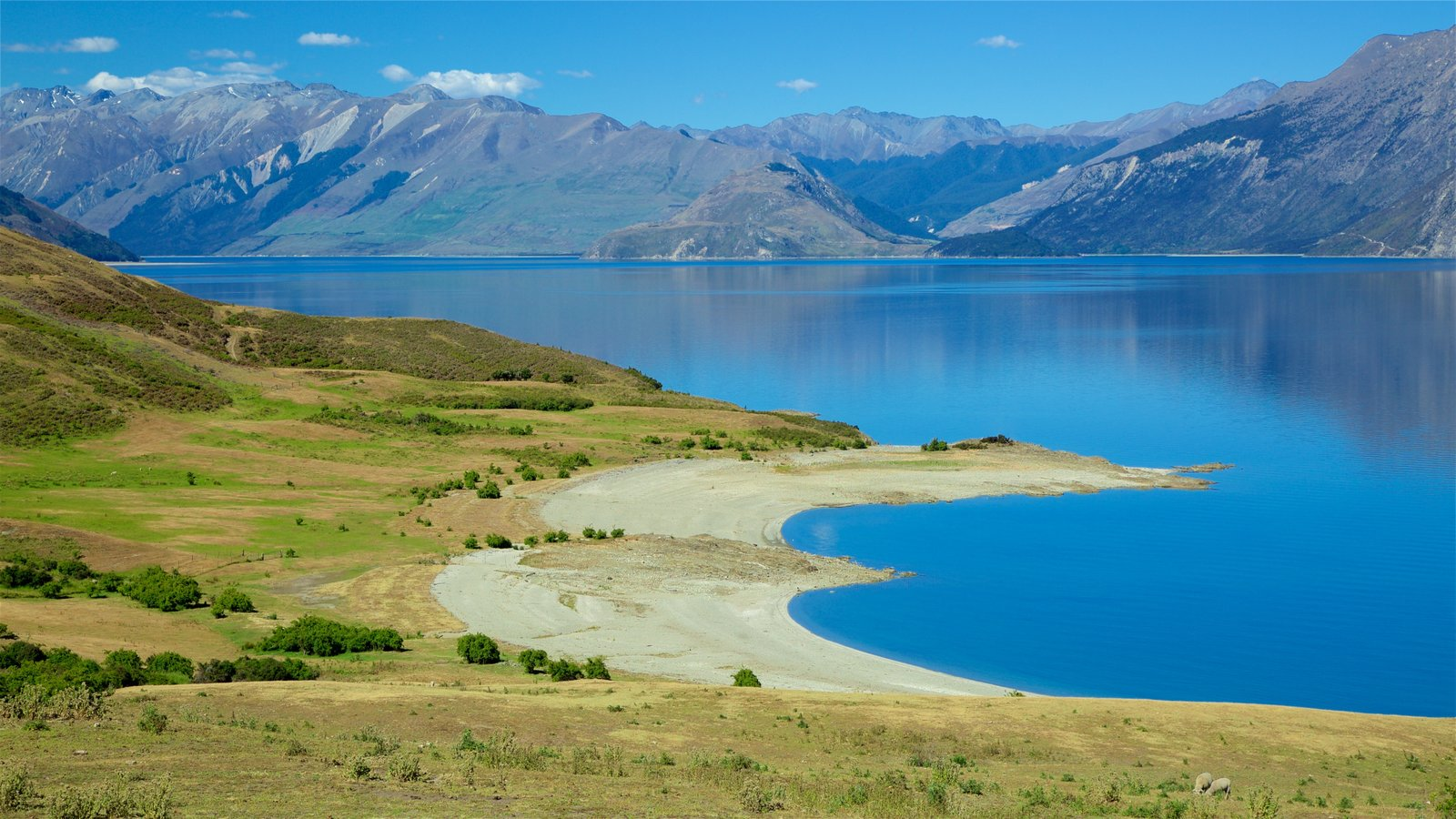 Lake Hawea which includes tranquil scenes, mountains and a lake or waterhole
