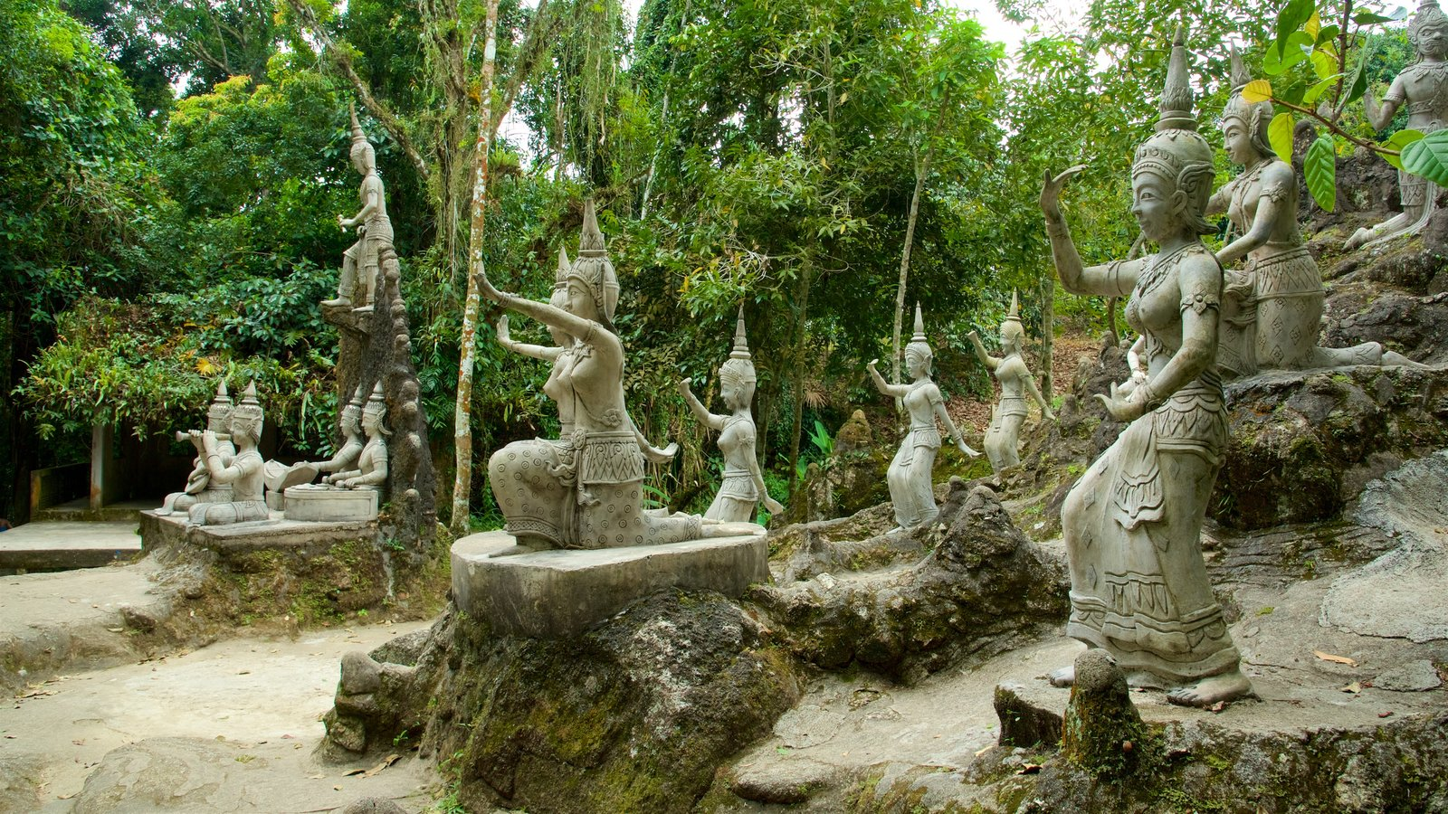 Secret Buddha Garden Which Includes A Park And A Statue Or Sculpture