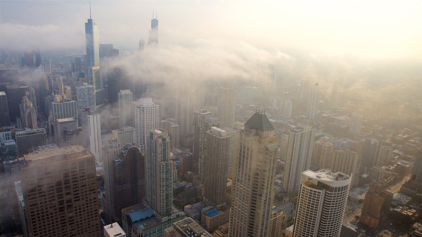 Willis Tower featuring a skyscraper, mist or fog and a city