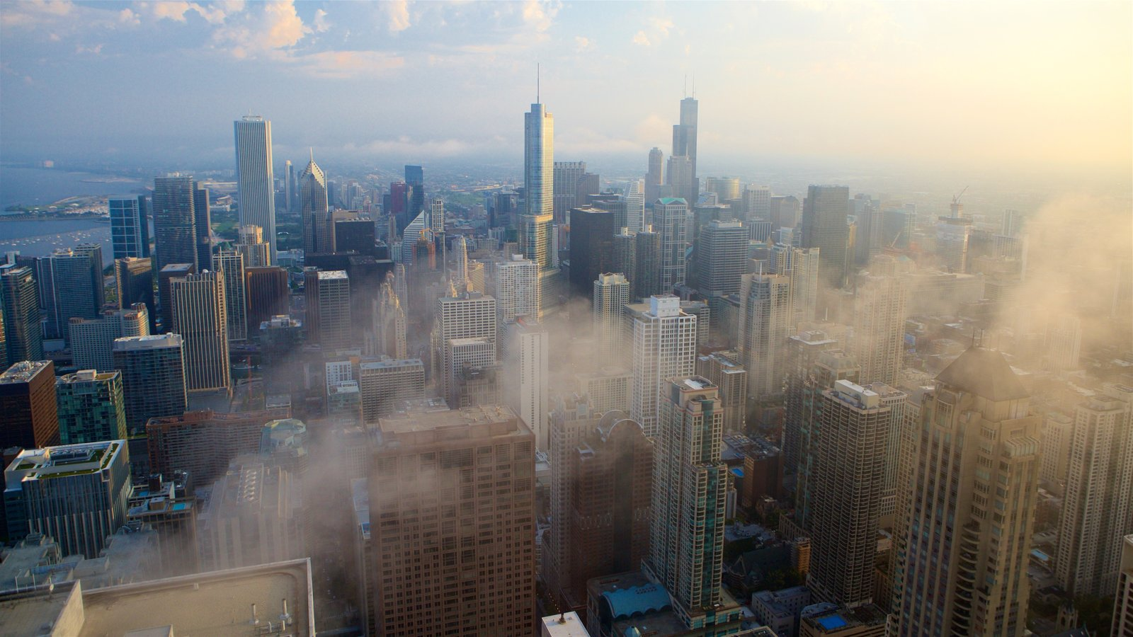 Willis Tower featuring mist or fog, a skyscraper and a city