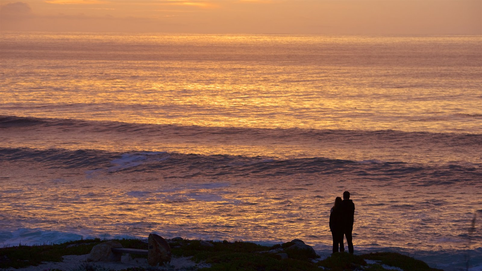 17-Mile Drive showing a beach and a sunset as well as a couple