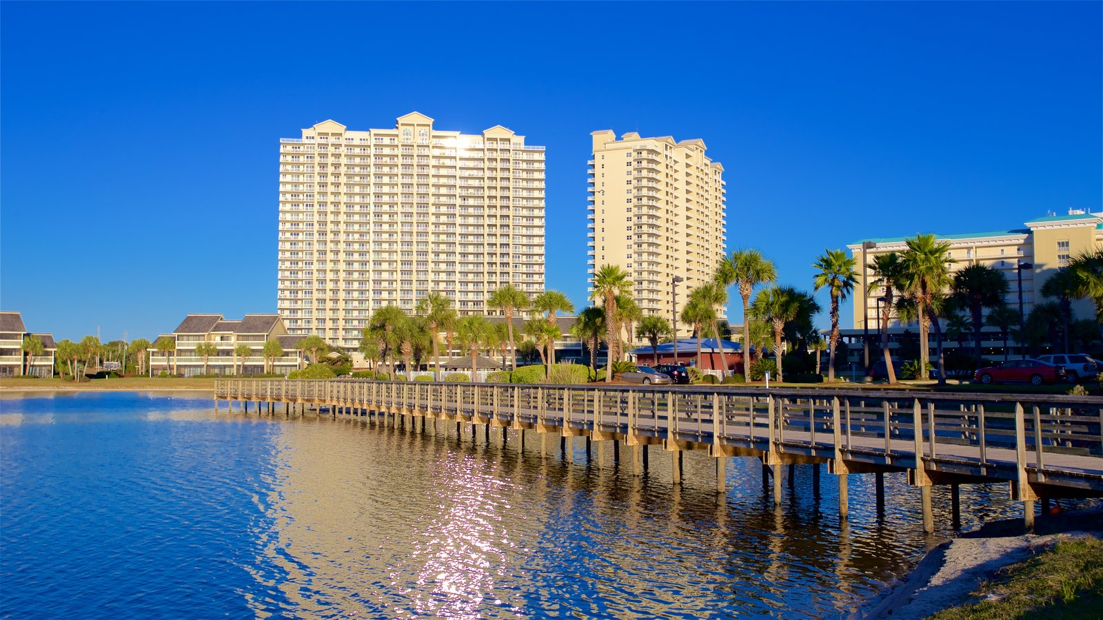 Florida Panhandle showing a coastal town, a bay or harbor and a skyscraper