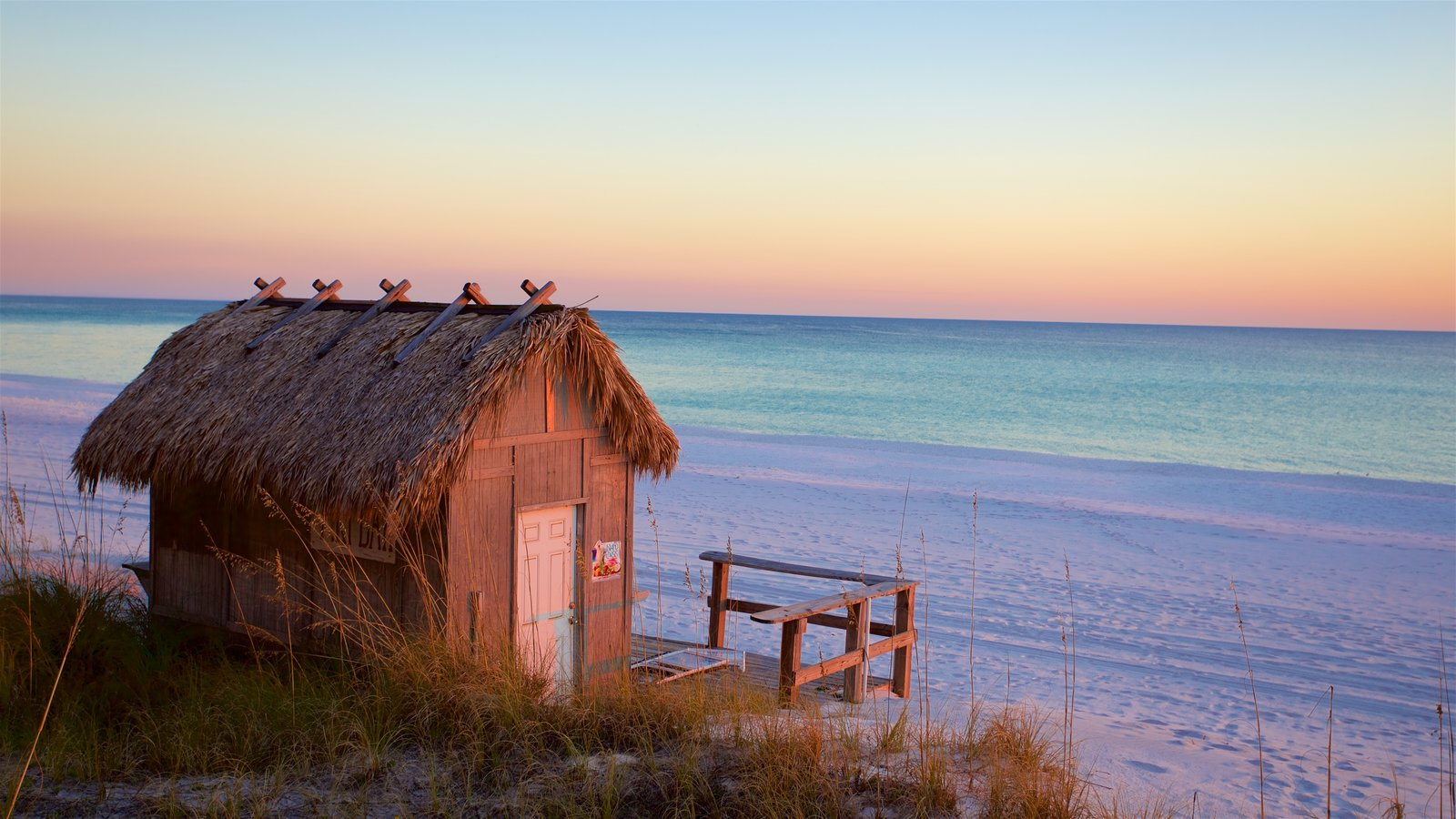 Florida Panhandle featuring a bay or harbor, a sunset and a beach