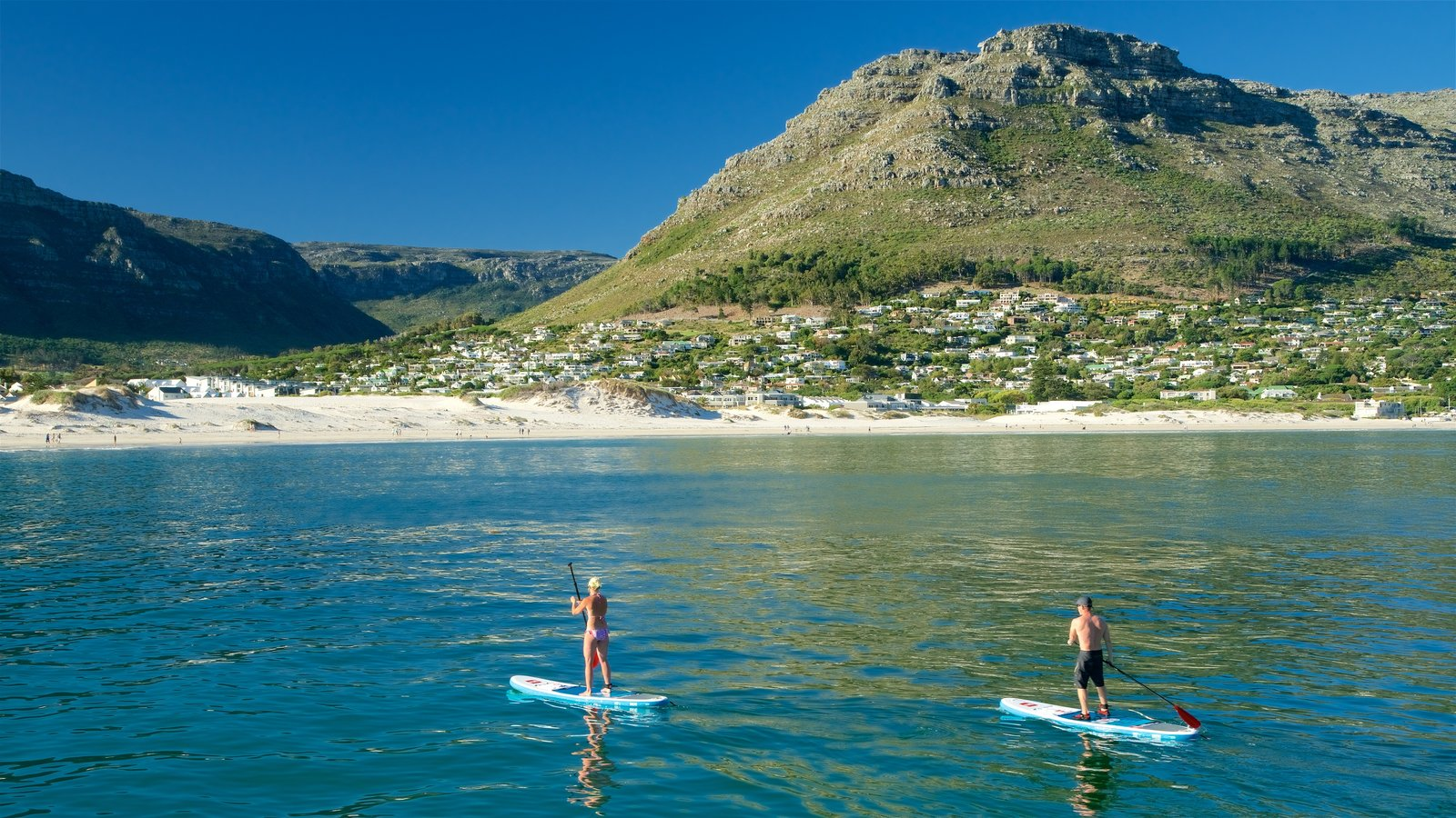 Hout Bay Beach which includes kayaking or canoeing as well as a couple