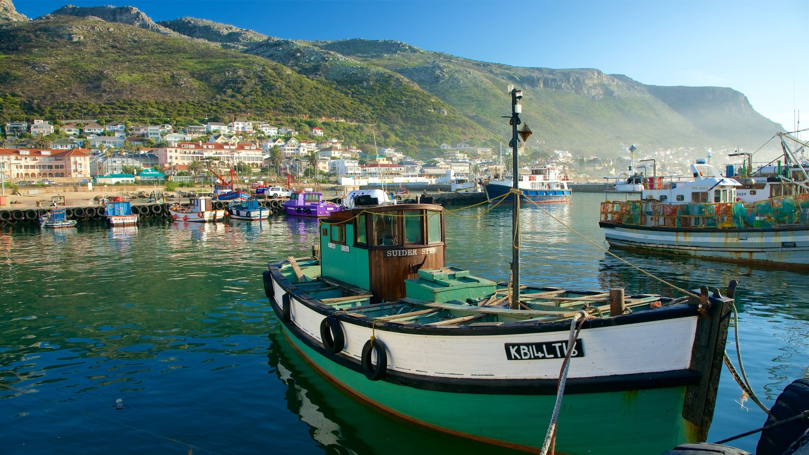 Kalk Bay which includes boating, a coastal town and a bay or harbour