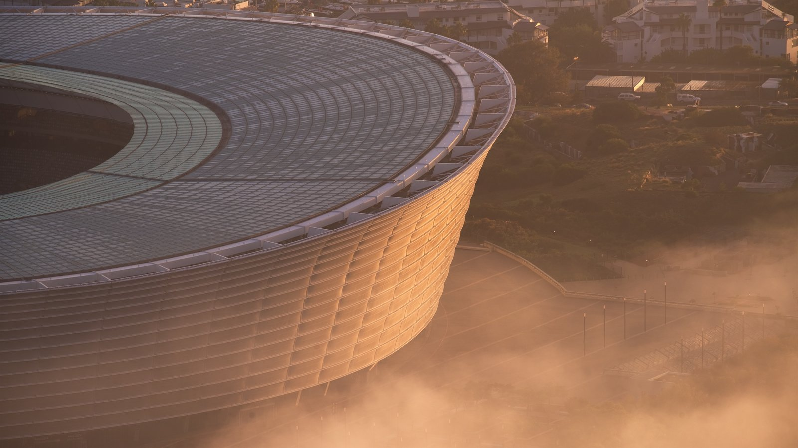 Cape Town Stadium which includes a city and a sunset
