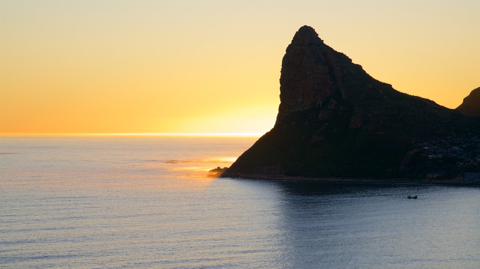 Chapmans Peak which includes a sunset and rocky coastline