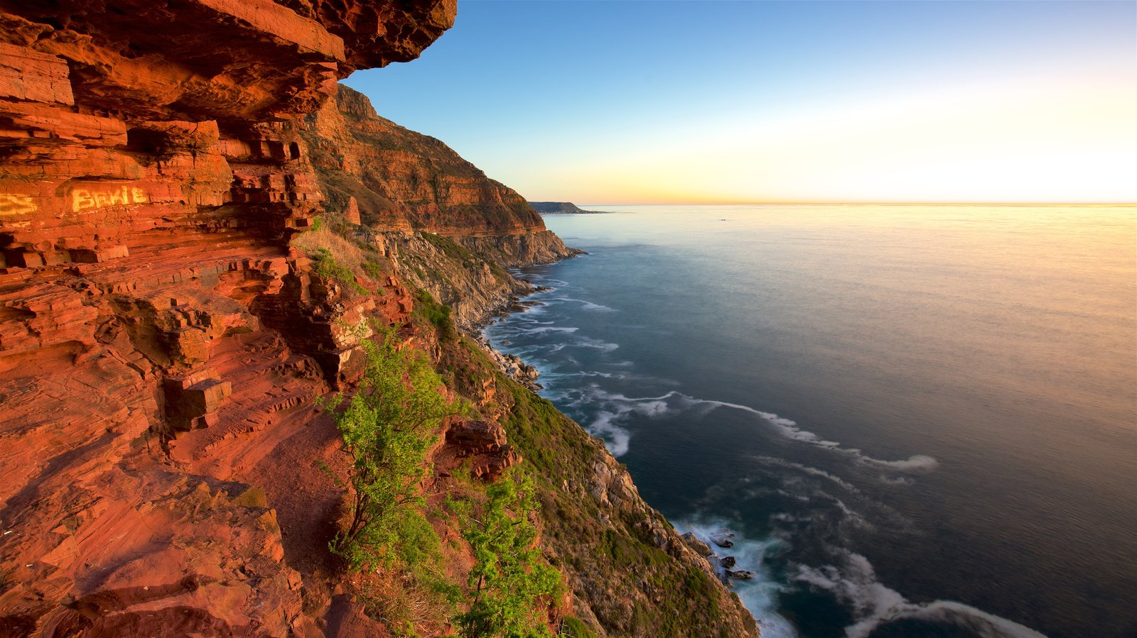Chapmans Peak showing rocky coastline and a sunset