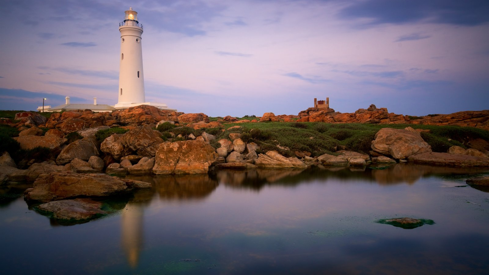 Seal Point Lighthouse featuring a sunset, general coastal views and rocky coastline