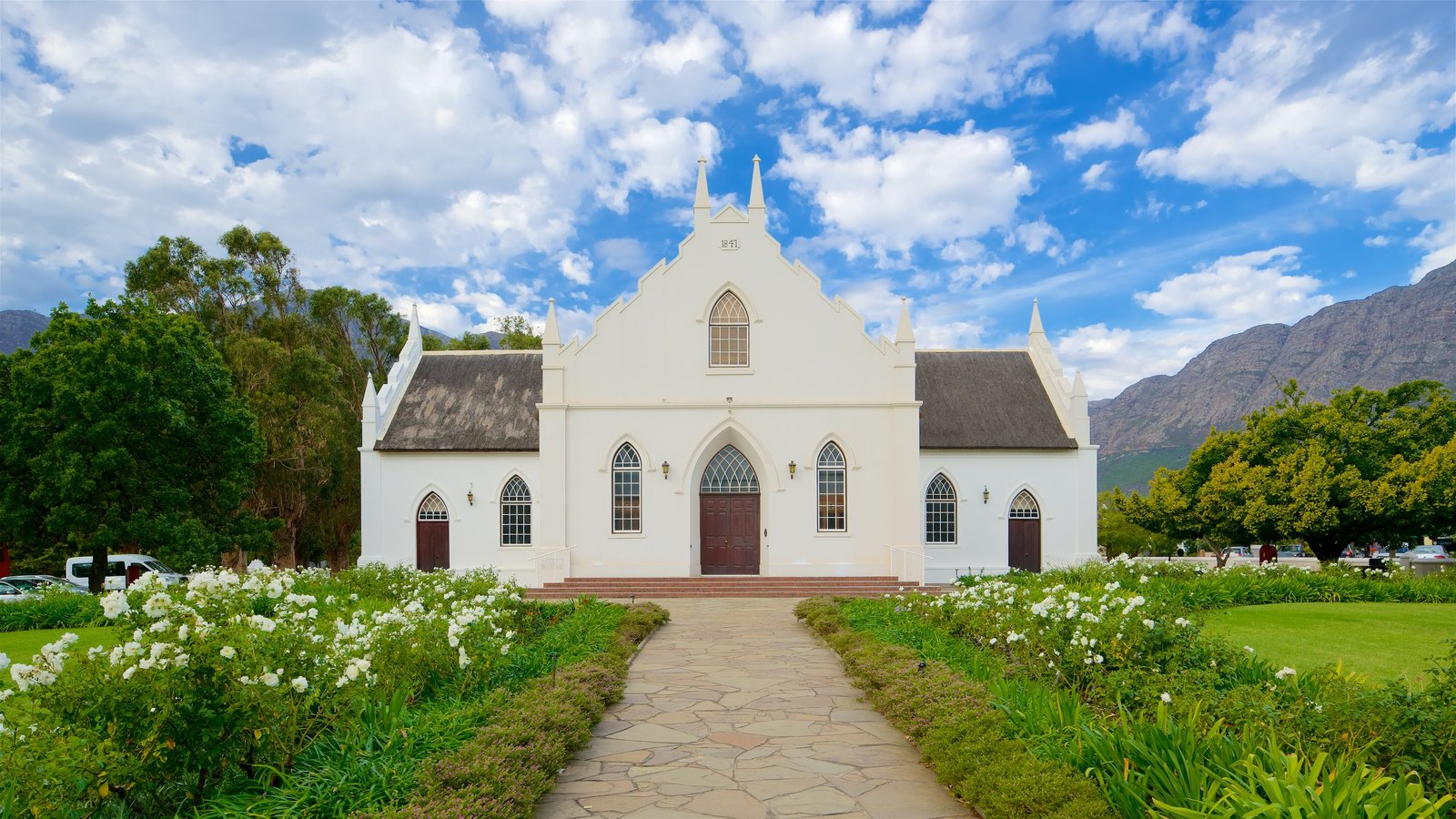 Franschhoek featuring flowers, a church or cathedral and heritage architecture