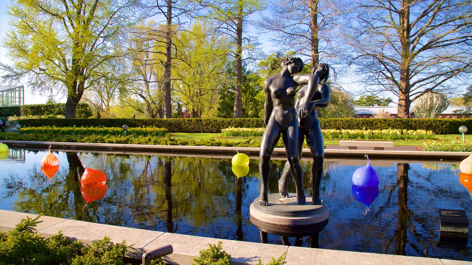 Missouri Botanical Gardens and Arboretum featuring a pond, a park and a statue or sculpture