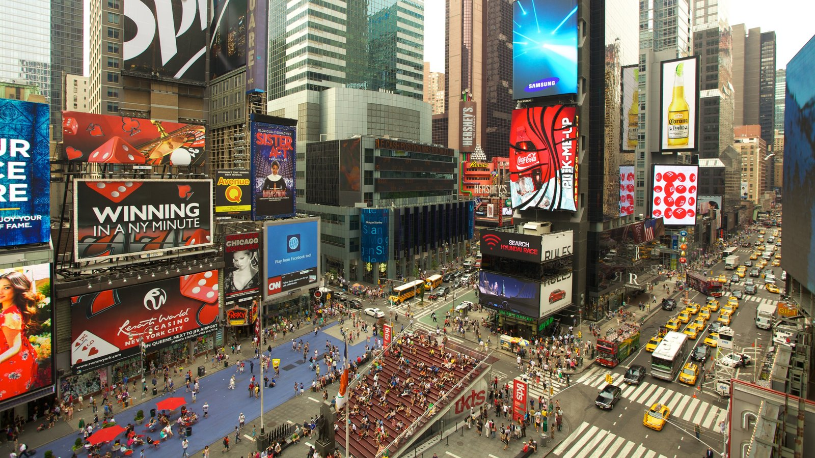 Times Square showing a high rise building, street scenes and signage