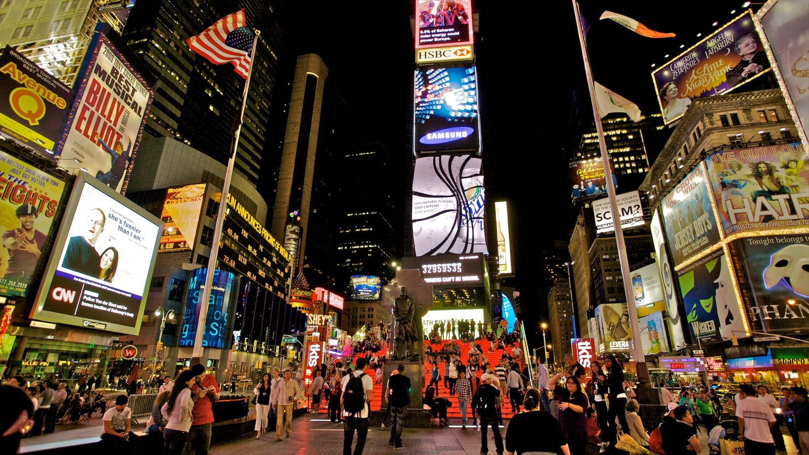 Times Square which includes a square or plaza, a high rise building and signage