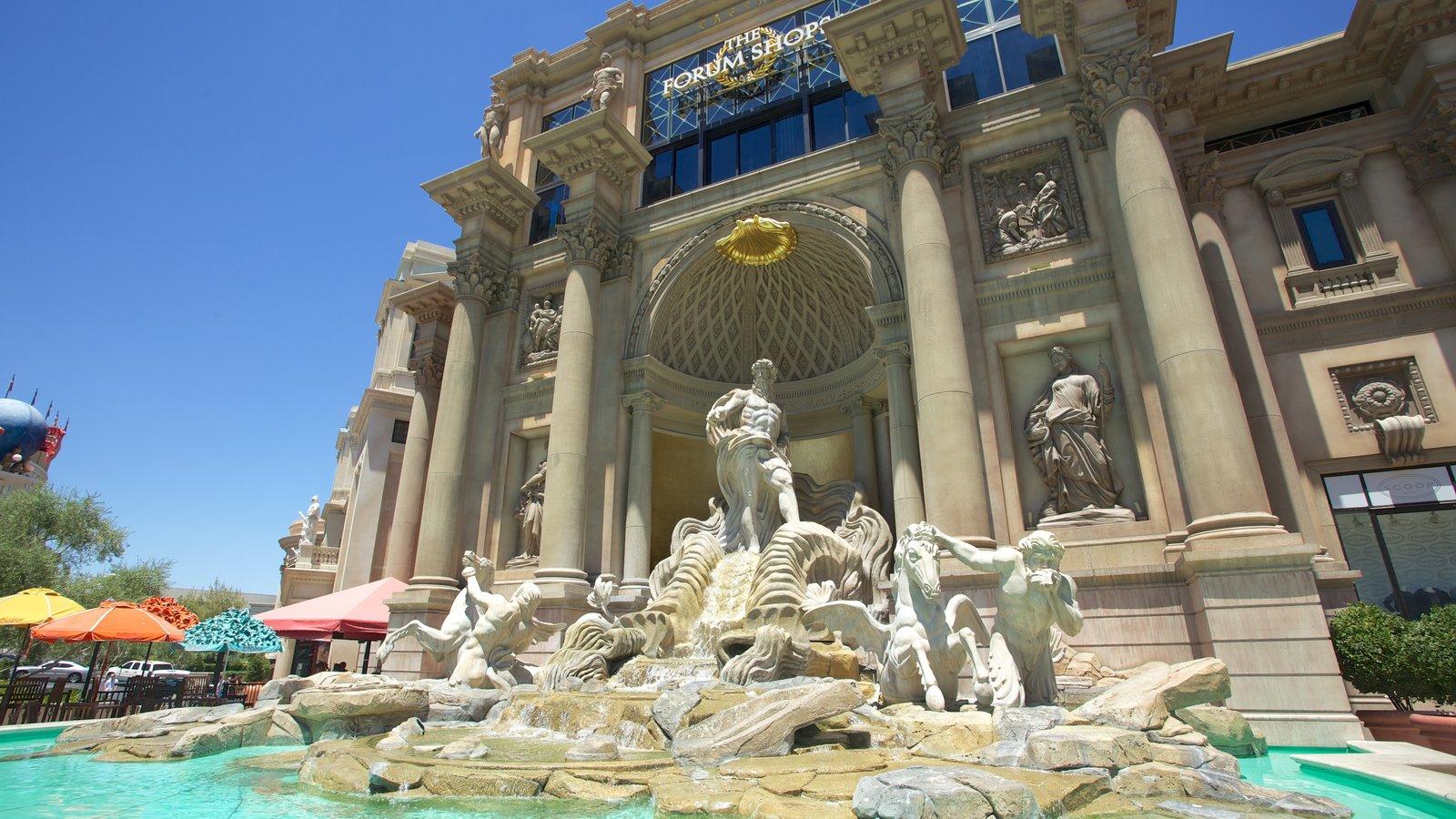 Centro comercial Forum Shops mostrando una fuente y una estatua o escultura