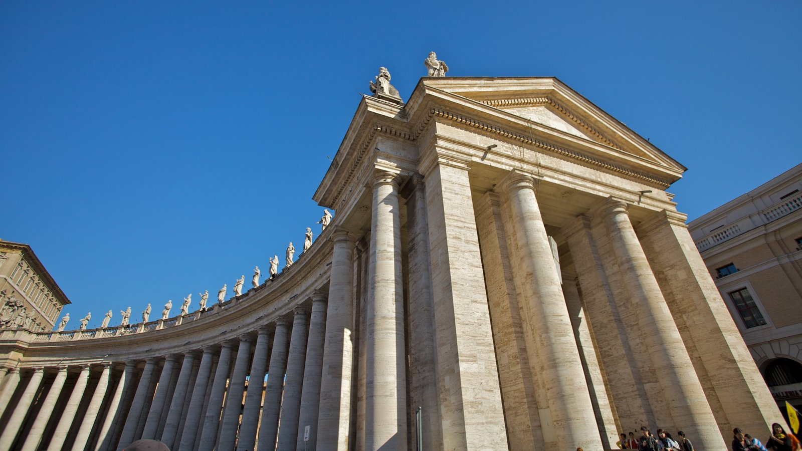 Piazza San Pietro which includes a square or plaza and heritage architecture