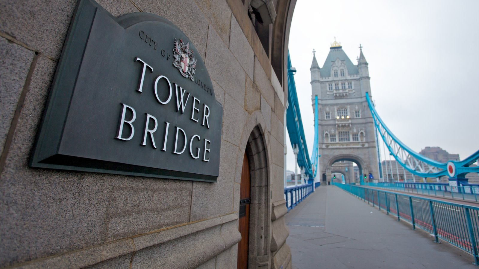 Tower Bridge which includes a monument, street scenes and signage